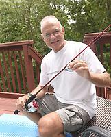 NWA Democrat-Gazette/FLIP PUTTHOFF <br />Barney Kunkel of Bella Vista, 2018 Northwest Arkansas Democrat-Gazette fish story champion, shows the rod and reel his grandson, Owen, used to catch a whopper catfish.