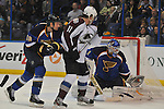 St. Louis Blues goalie Brian Elliott (1) has the puck trapped between his stick and his pads as Colorado Avalanche left wing Jamie McGinn (11) and St. Louis Blues defenseman Jay Bouwmeester (19) watch in the second period of a game between the Colorado Avalanche and the St. Louis Blues on Tuesday April 23, 2013 at the Scottrade Center in downtown St. Louis.