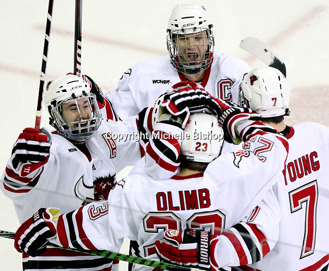UNO's Rich Purslow, Joey Martin and Michael Young celebrate Eric Olimb's goal. UNO beat St. Cloud State 3-0 Friday night at Qwest Center Omaha.  (Photo by Michelle Bishop)