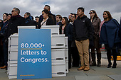 Activists stand behind boxes filled with letters to congress during a press conference urging action on DACA Dreamers on Capitol Hill in Washington, DC in February 13, 2019. Credit: Alex Edelman / CNP
