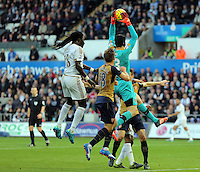Bafetimbi Gomis of Swansea is denied again a header by Petr Cech of Arsenal during the Barclays Premier League match between Swansea City and Arsenal at the Liberty Stadium, Swansea on October 31st 2015