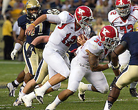 Youngstown State quarterback Kurt Hess (12) heads downfield behind the blocking of running back Jamaine Cook (35). The Youngstown St. Penguins defeated the Pittsburgh Panthers 31-17 on Saturday, September 1, 2012 at Heinz Field in Pittsburgh, PA.