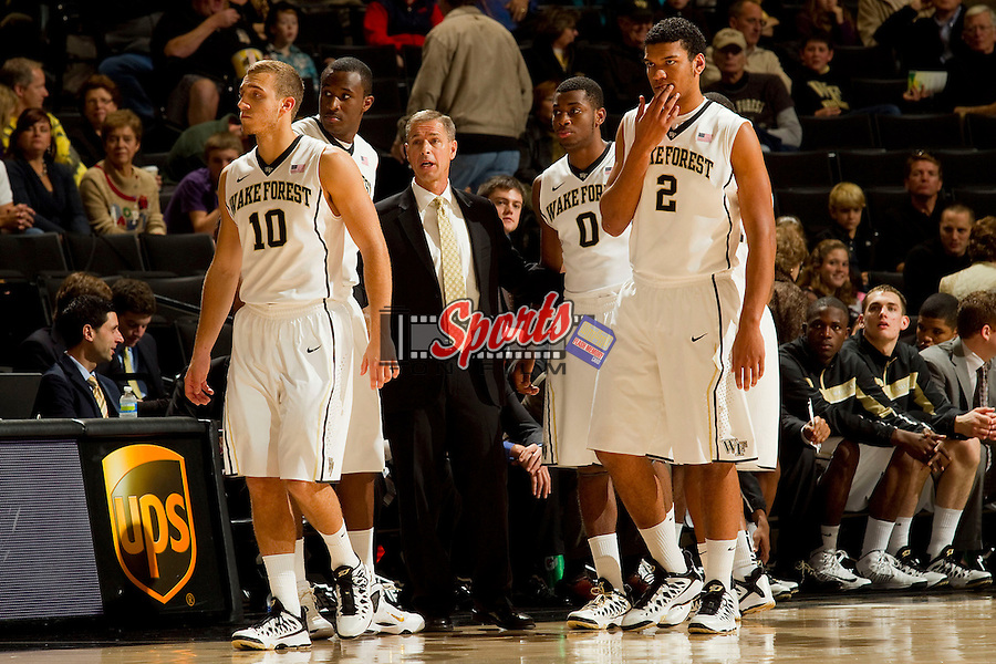 Wake Forest Demon Deacons head coach Jeff Bzdelik (center) huddles with his team during a stoppage in play during the game against the Seton Hall Pirates at the LJVM Coliseum on December 8, 2012 in Winston-Salem, North Carolina.  The Pirates defeated the Demon Deacons 71-67.    (Brian Westerholt/Sports On Film)