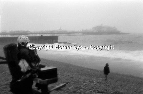 Brighton beach children bad weather. 1969