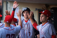 Syracuse Chiefs center fielder Trea Turner (7) high fives teammates after scoring a run during a game against the Rochester Red Wings on July 1, 2016 at Frontier Field in Rochester, New York.  Rochester defeated Syracuse 5-3.  (Mike Janes/Four Seam Images)