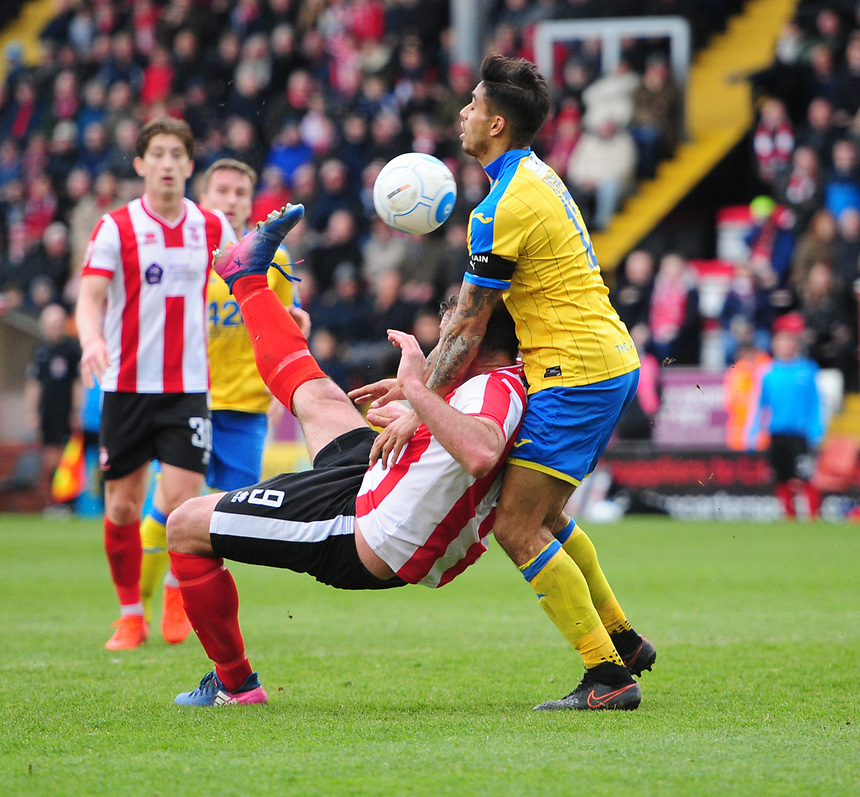 Lincoln City's Matt Rhead attempts an over-head kick under pressure from Torquay United's Aman Verma<br /> <br /> Photographer Chris Vaughan/CameraSport<br /> <br /> Vanarama National League - Lincoln City v Torquay United - Friday 14th April 2016  - Sincil Bank - Lincoln<br /> <br /> World Copyright &copy; 2017 CameraSport. All rights reserved. 43 Linden Ave. Countesthorpe. Leicester. England. LE8 5PG - Tel: +44 (0) 116 277 4147 - admin@camerasport.com - www.camerasport.com