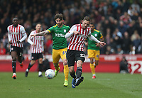 Brentford's Henrik Dalsgaard and Preston North End's Sean Maguire<br /> <br /> Photographer Rob Newell/CameraSport<br /> <br /> The EFL Sky Bet Championship - Brentford v Preston North End - Sunday 5th May 2019 - Griffin Park - Brentford<br /> <br /> World Copyright © 2019 CameraSport. All rights reserved. 43 Linden Ave. Countesthorpe. Leicester. England. LE8 5PG - Tel: +44 (0) 116 277 4147 - admin@camerasport.com - www.camerasport.com