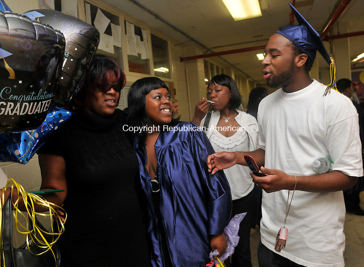 WATERBURY, CT- 11 June 2010 - 061110IP01- State Street High School graduate Dennaysia Newton (middle) celebrates with her mother Talisha Newton and her brother Dennis Newton, who is wearing her cap, after the Alternative Programs Commencement Ceremony for Enlightenment School, Excel Programs and State Street School at Mattatuck Museum in Waterbury on Friday.<br /> Irena Pastorello Republican-American