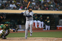 OAKLAND, CA - JUNE 14:  Mac Williamson #12 of the Seattle Mariners bats against the Oakland Athletics during the game at the Oakland Coliseum on Friday, June 14, 2019 in Oakland, California. (Photo by Brad Mangin)