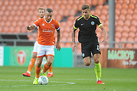 Blackpool's Jay Spearing under pressure from Macclesfield Town's Jacob Blyth<br /> <br /> Photographer Kevin Barnes/CameraSport<br /> <br /> The Carabao Cup First Round - Blackpool v Macclesfield Town - Tuesday 13th August 2019 - Bloomfield Road - Blackpool<br />  <br /> World Copyright © 2019 CameraSport. All rights reserved. 43 Linden Ave. Countesthorpe. Leicester. England. LE8 5PG - Tel: +44 (0) 116 277 4147 - admin@camerasport.com - www.camerasport.com
