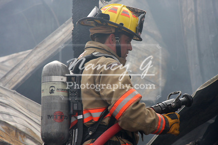 A firefighter holding a hose