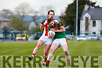 Rathmore Kevin O'Gorman and  Donal O'Sullivan Kilcummin in a midfield battle during the Club Championship clash in Rathmore Wednesday evening