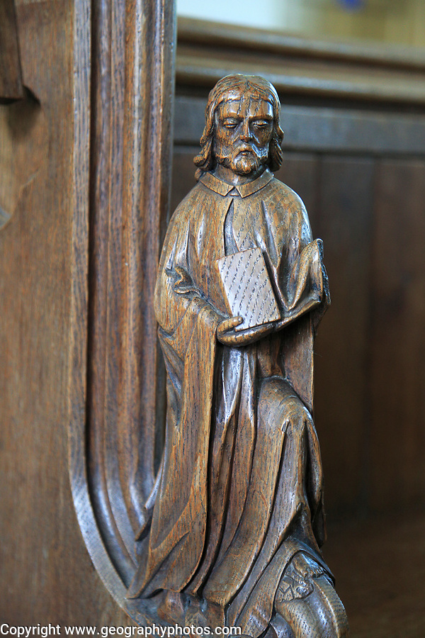 Carved wooden pew end figure,  Huntingfield church, Suffolk, England, UK