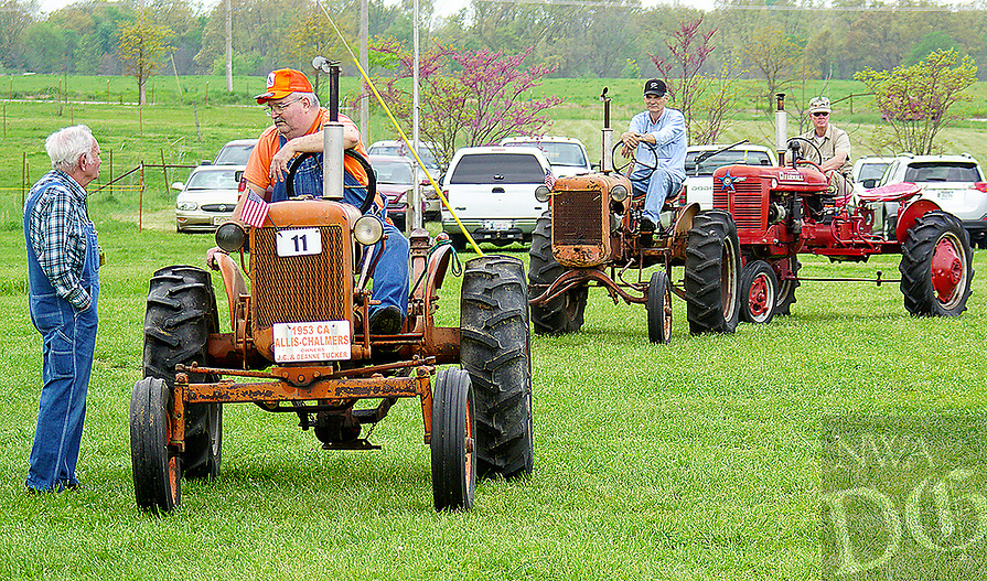 Photo by Randy Moll<br /> Antique tractors lined up Friday for the parade of power held each noon at the Tired Iron of the Ozarks showgrounds in Gentry. The show features antiquie tractors, engines, farm machinery, a sawmill, blacksmith shop and more.