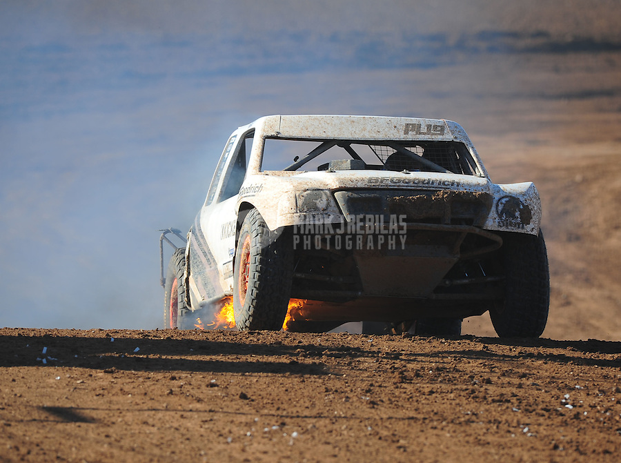 Apr 16, 2011; Surprise, AZ USA; LOORRS driver Corey Sisler on fire during round 3 at Speedworld Off Road Park. Mandatory Credit: Mark J. Rebilas-.