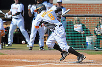 Khayyan Norfork #8 of the Tennessee Volunteers lays down a bunt at Lindsey Nelson Stadium against the the Manhattan Jaspers on March 12, 2011 in Knoxville, Tennessee.  Tennessee won the first game of the double header 11-5.  Photo by Tony Farlow / Four Seam Images..