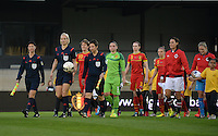 20140410 - LEUVEN , BELGIUM : Both teams with referees pictured before the female soccer match between Belgium and Norway, on the seventh matchday in group 5 of the UEFA qualifying round to the FIFA Women World Cup in Canada 2015 at Stadion Den Dreef , Leuven . Thursday 10th April 2014 . PHOTO DAVID CATRY