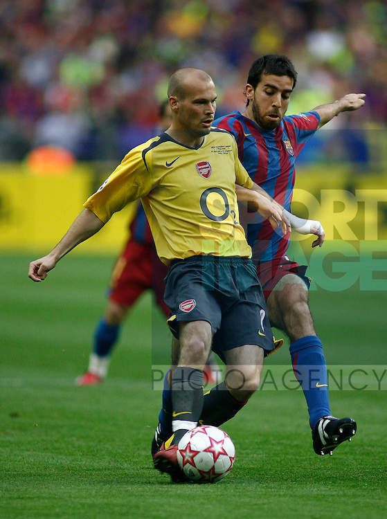 Barcelona's Oleguer and Arsenal's Fredrick Ljungberg