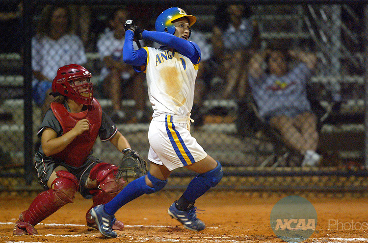 16 MAY 2004:  Centerfielder Michelle Hofmann (9) of Angelo State watches her 3-run homerun sail over the fence against Florida Southern during the Division II Women's Softball Championship game held at the Seminole Softball Complex in Altamonte Springs, FL.  Angelo State defeated Florida Southern 7-3 for the national title.  Jamie Schwaberow/NCAA Photos
