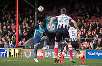 Adebayo Akinfenwa of Wycombe Wanderers hits the ball into the area during the Sky Bet League 2 match between Grimsby Town and Wycombe Wanderers at Blundell Park, Cleethorpes, England on 4 March 2017. Photo by Andy Rowland / PRiME Media Images.
