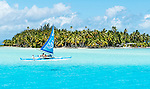 Blue boat sailing in Bora Bora lagoon, French Polynesia