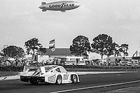 GoodYear Blimp flies above the #09 Porsche 935 of Derek Bell, Michael Andretti, John Paul Jr., 57th place, 12 Hours or Sebring, Sebring International Raceway, Sebring, FL, March 19, 1983.  (Photo by Brian Cleary/bcpix.com)