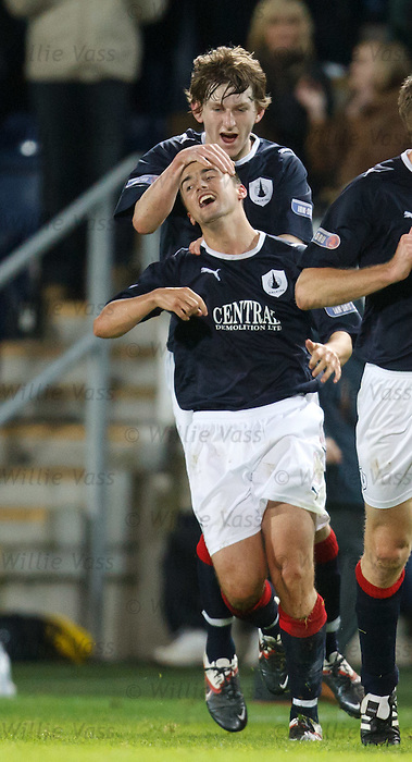 Mark Millar is mobbed after his winning free-kick for Falkirk