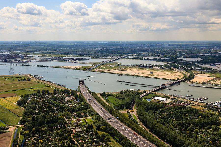 Nederland, Noord-Holland, Amsterdam, 14-06-2012; Buiten-IJ met ring A10 en Zeeburgertunnel, Zeeburgerbrug, Schellingerwouderbrug(r)  en eiland Zeeburg (Zeeburger eiland). De tunnel verbindt Amsterdam-Noord met de rest van Amsterdam. In de industriële silo's (voormalige waterzuiveringsinstallatie) op Zeeburg wordt het Annie M.G. Schmidt Huis gevestigd..Zeeburgertunnel (tunnel) and Zeeburgerbrug connecting  the north and the south of Amsterdam, the Zeeburgereiland (isle) in between..luchtfoto (toeslag), aerial photo (additional fee required).foto/photo Siebe Swart