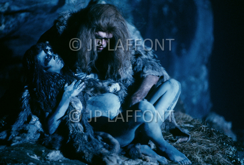 """Toronto area, Canada.1981. 80,000 years ago, the tribe who posessed fire, posessed life. A primitive tribe try to keep a natural fire source for survival.  This part of the movie was filmed in Canada.  """"Quest for Fire"""" (La guerre du feu) by French director Jean-Jacques Annaud, and based on the novel of JH Rosny. Love scene under the moon light."""