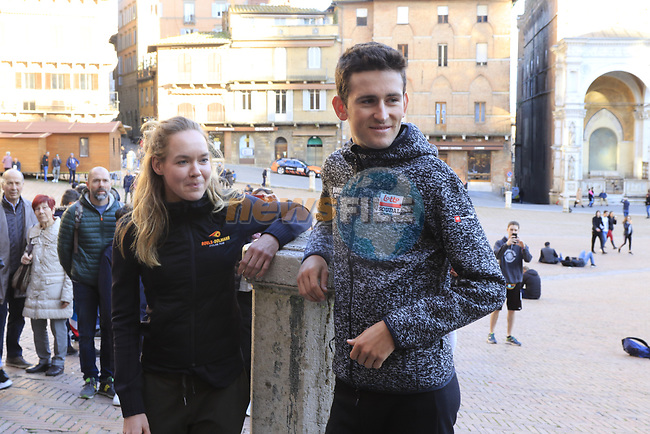 Last year's winners Tiesj Benoot (BEL) Lotto-Soudal and World Champion Anna Van der Breggen (NED) Boels Dolmans pose for pictures in Il Campo Siena finish line of the 2019 Strade Bianche running 184km from Siena to Siena, held over the white gravel roads of Tuscany, Italy. 8th March 2019.<br /> Picture: Eoin Clarke | Cyclefile<br /> <br /> <br /> All photos usage must carry mandatory copyright credit (© Cyclefile | Eoin Clarke)