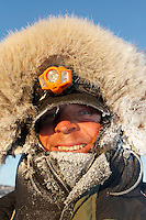Lachlan Clarke is bundled up againts the 20 below zero cold at the ghost-town checkpoint of Iditarod  on Friday morning during the 2011 Iditarod race..
