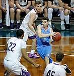SIOUX FALLS, SD - MARCH 9:  Trae Vandeberg #3 from Dakota Wesleyan drives to the basket between a trio of defenders including Aziz Leeks #22 from the College of Idaho during their second round game at the 2018 NAIA DII Men's Basketball Championship at the Sanford Pentagon in Sioux Falls. (Photo by Dick Carlson/Inertia)