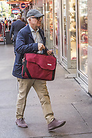 Steve Martin tried to lift up her bag to cover his face from the photographer but its too heavy for him. New York City, USA, October 10, 2017.