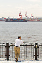 May 23, Tokyo, Japan - A man takes a break near a cargo area at a port in Tokyo. According to the Ministry of Finance Japan report, the country acquired a trade balance of 520.27 billion yen in April, compared with 470.8 billion yen in the previous year. Exports increased 7.9 percent from a year earlier which was below the expected 11.8 increase economists had hoped for. Imports, on the other hand, saw a 8.0 percent increase to 6.087 trillion yen. (Photo by: Christopher Jue/AFLO)