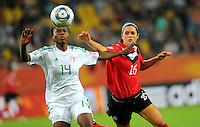 Jonelle Filigno (r) of team Canada and Faith Ikidi of team Nigeria during the FIFA Women's World Cup at the FIFA Stadium in Dresden, Germany on July 5th, 2011.