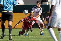 Chicago Fire forward Collins John is pushed from behind by Omar Gonzalez of the Galaxy. The Chicago Fire beat the LA Galaxy 3-2 at Home Depot Center stadium in Carson, California on Sunday August 1, 2010.