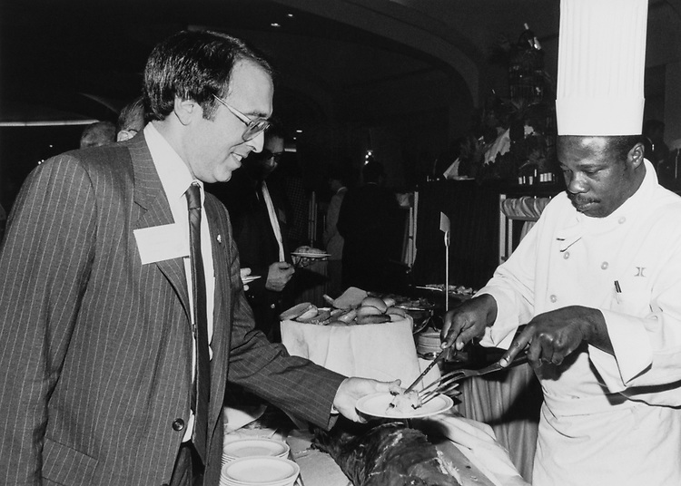 Rep. Howard Wolpe, D-Mich., being served by chef in 1985. (Photo by Adele Starr/CQ Roll Call)
