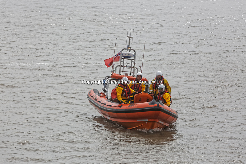 Pictured: An RNLI crew arrives for the rescue scenarion. Friday 20 April 2018 <br /> Re: The Royal National Lifeboat Institution (RNLI) and the Maritime and Coastguard Agency (MCA) have held a special media event to demonstrate how drones could be used in search and rescue activity in the future to help save lives at the Atlantic College in St Donats, south Wales, UK. <br /> The rescue scenario took place along a stretch of coastline in south Wales, featuring a drone, an RNLI lifeboat and an MCA helicopter winching the casualty to safety.