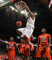Virginia forward Akil Mitchell (25) dunks the ball during the game against Clemson Thursday in Charlottesville, VA.