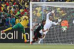 11 JUN 2010: The ball flies past Katlego Mphela (RSA) (9), Carlos Salcido (MEX) (3) and Oscar Perez (MEX) (1). The South Africa National Team tied the Mexico National Team 1-1 at Soccer City Stadium in Johannesburg, South Africa in the opening match of the 2010 FIFA World Cup.