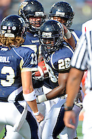 9 October 2010:  FIU running back Darriet Perry (28) celebrates his second-quarter touchdown with teammates Wesley Carroll (13), Brad Serini (76) and others as the FIU Golden Panthers defeated the Western Kentucky Hilltoppers, 28-21, at FIU Stadium in Miami, Florida.