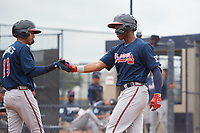 Atlanta Braves Darling Florentino (18) is congratulated by Juan Morales (19) after hitting a home run during a Minor League Spring Training game against the New York Yankees on March 12, 2019 at New York Yankees Minor League Complex in Tampa, Florida.  (Mike Janes/Four Seam Images)