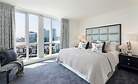 BNPS.co.uk (01202 558833)<br /> Pic:  Johns&Co/BNPS<br /> <br /> Bedroom also has stunning views.<br /> <br /> Fancy joining the Premier league of London property?<br /> <br /> A luxurious London apartment that has been home to a string of Premier League footballers has emerged for sale for close to £2m.<br /> <br /> The lavish home is on the 25th and 26th floors of the stylish Ontario Tower in Ballymore, close to Canary Wharf.<br /> <br /> It's prime location and stylish facilities have made it a favourite of West Ham United players with three internationals having lived there.