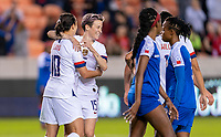 HOUSTON, TX - JANUARY 28: Carli Lloyd #10 and Megan Rapinoe #15 of the United States celebrate a goal during a game between Haiti and USWNT at BBVA Stadium on January 28, 2020 in Houston, Texas.