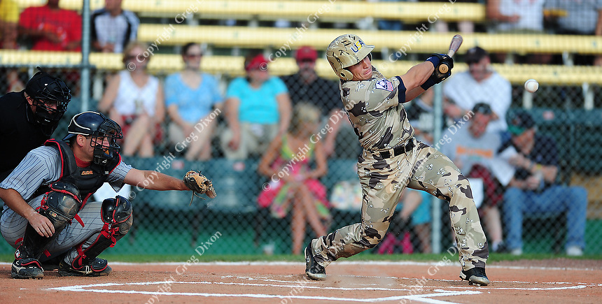 Bruce Jezwinski connects with the ball as the US Military All-Stars go up against Home Talent All-Stars on Sunday at Warner Park.