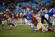 Duke Blue Devils running back Josh Snead #9 carries the ball as Florida State Seminoles defensive tackle Timmy Jernigan #8 tackles him in third quarter of the 2013 ACC Championship game against the Florida State Seminoles at the Bank of America Stadium in Charlotte. FSU defeated Duke 45-7.  (Photo by Don Baxter/Media Images International)