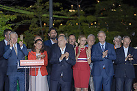 Hungarian Prime Minister Viktor Orban (front 3rd L) and fans of his government party Fidesz celebrates their victory during the European Parliamentary election in Budapest, Hungary on May 26, 2019. ATTILA VOLGYI