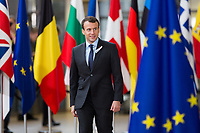 Emmanuel Macron arrives at the EU summit meeting,  at the European Union headquarters in Brussels