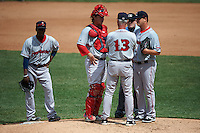 Pawtucket Red Sox pitching coach Bob Kipper (13) talks with pitcher Steven Wright (32) and catcher Matt Spring (47) with umpire Sean Barber during a game against the Rochester Red Wings on July 1, 2015 at Frontier Field in Rochester, New York,  shortstop Jemile Weeks (2) is at left.  Rochester defeated Pawtucket 8-4.  (Mike Janes/Four Seam Images)