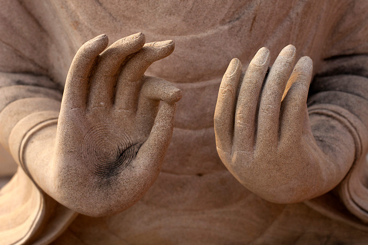 Details of a Buddha statue's hands in a temple in a village near Battambang, Cambodia. <br /> <br /> Photos &copy; Dennis Drenner 2013.